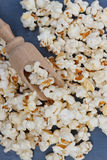 Lot of popcorn and a small wooden spatula Stock Image