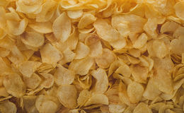 A lot of potatoes chips. Yellow salted potato chips as background. Stock Photography