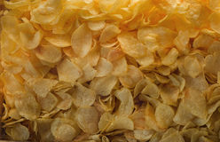 A lot of potatoes chips. Yellow salted potato chips as background. Royalty Free Stock Photo
