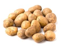 Pile of raw potatoes on a white background Royalty Free Stock Images