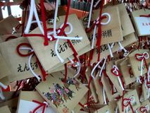 Prayers and wishes written on small wooden tables outside a Shinto shrine in Japan stock image