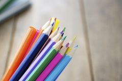 Lot of the rainbow pencils and felt-tip pens. On the wooden table royalty free stock photos