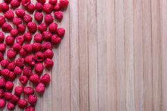 Lot of rapsberry. A lot of rapsberry on a wooden background Stock Image