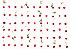 Lot of raspberries and cherries arranged on white Royalty Free Stock Images