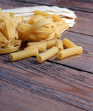 Lot of raw pasta Royalty Free Stock Photography