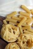 Lot of raw pasta Stock Photo