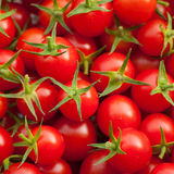 A lot of red cherry tomato. A group of red cherry tomato royalty free stock image