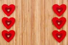 A lot of red hearts on a wooden background, a greeting card for Valentine`s Day. With some free space for your text or sign. Valentines day Stock Photo