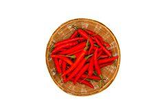 A lot of red hot chilli pepper in weave basket  on white background. And top view. Freshness vegetables Royalty Free Stock Photography