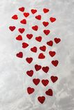 A lot of red paper hearts on grey concrete background. Valentine`s Day card. A lot of red paper hearts on the grey concrete background. Valentine`s Day card Royalty Free Stock Photos