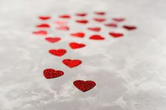 A lot of red paper hearts on grey concrete background. Valentine`s Day card. A lot of red paper hearts on the grey concrete background. Valentine`s Day card Royalty Free Stock Photo