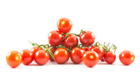 A lot of red small cherry tomatoes on a white background.  royalty free stock photos