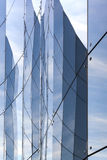 Lot of reflections in glass facade of building Stock Photo