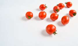 A lot of ripe mini cherry tomato on a white background. royalty free stock image