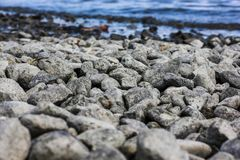 Lot of rocks on the beach near the sea - great for a cool wallpaper
