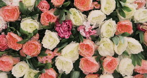 A lot of roses and Peonies stand in pots buckets, a Large Bouquet of Roses and Peonies, beautiful flower field yellow stock video