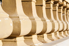 Lot of round columns in perspective closeup.  Stock Photos