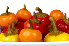 A lot of round hot peppers of different colors. In a plate Stock Photography