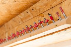 Red router bits. A lot of router bits in a row Stock Image