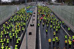 Lot of runner in yellow vests Royalty Free Stock Image