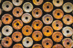 Lot of rust circle aluminum on black background Stock Images