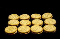 Lot`s and lot`s or sweet round cookie`s. A cookie is a baked or cooked food that is small, flat and sweet. It usually contains flour, sugar and some type of oil Royalty Free Stock Photography