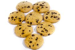 Lot`s of round sweet fresh chocolate chip cookie;s. A cookie is a baked or cooked food that is small, flat and sweet. It usually contains flour, sugar and some Royalty Free Stock Photos