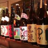 A lot of sake. Bottles with sake Stock Images