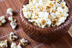 Lot of salt popcorn into a bamboo bowl. Close up Royalty Free Stock Image