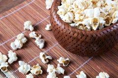 Lot of salt popcorn into a bamboo bowl. Close up Royalty Free Stock Photos