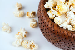 Lot of salt popcorn into a bamboo bowl Royalty Free Stock Image