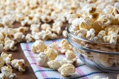 Lot of salt popcorn into a bowl. Close up Royalty Free Stock Photos