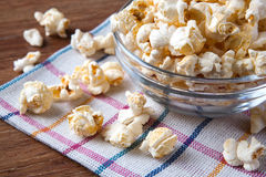 Lot of salt popcorn into a bowl. Close up royalty free stock images