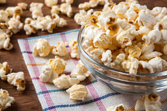 Lot of salt popcorn into a bowl. Close up stock photography