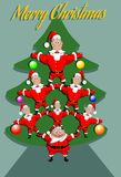 A lot of Santa Clauses built a living pyramid in the form of a New Year tree Royalty Free Stock Images