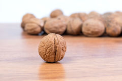 A lot of scattered walnuts close-up. A useful product. Stock Photography