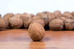 A lot of scattered walnuts close-up. A useful product. Stock Photos