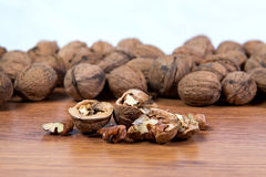 A lot of scattered walnuts close-up. A useful product. Royalty Free Stock Photography
