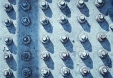 A lot of screw heads Royalty Free Stock Photography