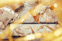 A lot of sea theme in mess like shells, candles, perfume, girl stuff on linen, pretty textured post card view vintage Royalty Free Stock Image