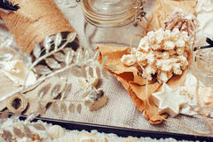 A lot of sea theme in mess like shells, candles, perfume, girl stuff on linen, pretty textured post card view vintage Royalty Free Stock Photos