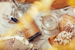 A lot of sea theme in mess like shells, candles, perfume, girl stuff on linen, pretty textured post card view vintage Stock Photos