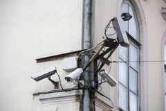 A lot of Security cctv cameras on the wall. Security cctv cameras on the grey wall Stock Image