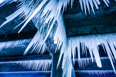 Lot of sharp and long icicles Royalty Free Stock Photography
