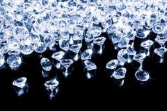 Shiny diamonds on a black background royalty free stock image