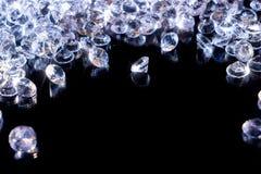 Shiny diamonds on a black background royalty free stock images