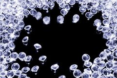 Shiny diamonds on a black background. A lot of shiny diamonds on a black surface stock photos