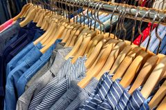Lot of shirt on hanger. In weekend market Royalty Free Stock Photos