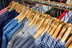 Lot of shirt on hanger Royalty Free Stock Photos