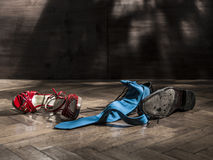 Lot of shoes scattered turns of after the party Royalty Free Stock Photos